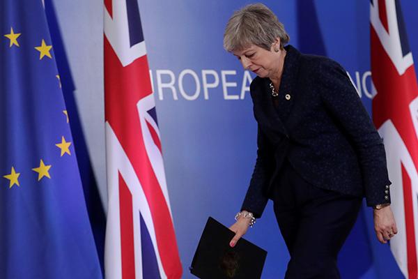 May intentará persuadir a Parlamento dividido
